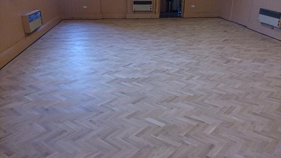 Vilige Hall.Supply and Fit parquet blocks in herringbone disigne also sand polish and varnishing